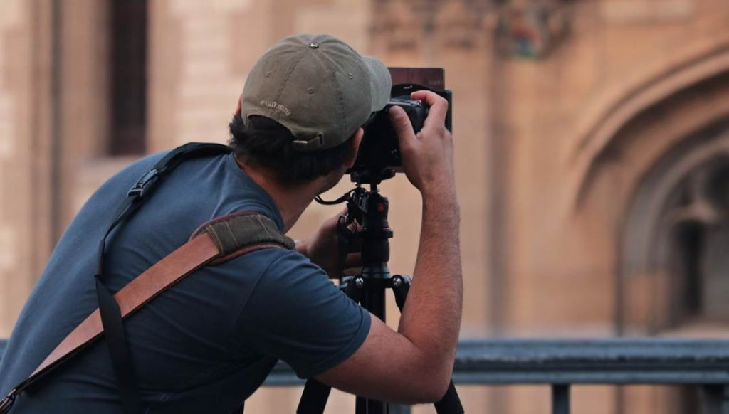 Image of Human Taking a photograph