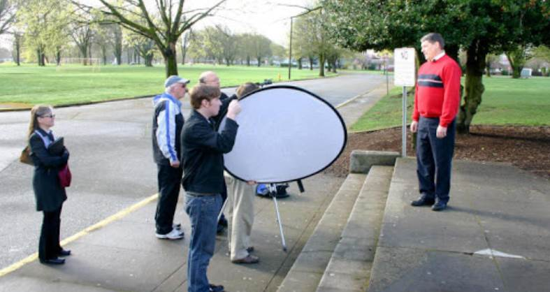 Image of a man getting photographed on street