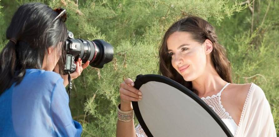 Image of a women using reflector silver reflector