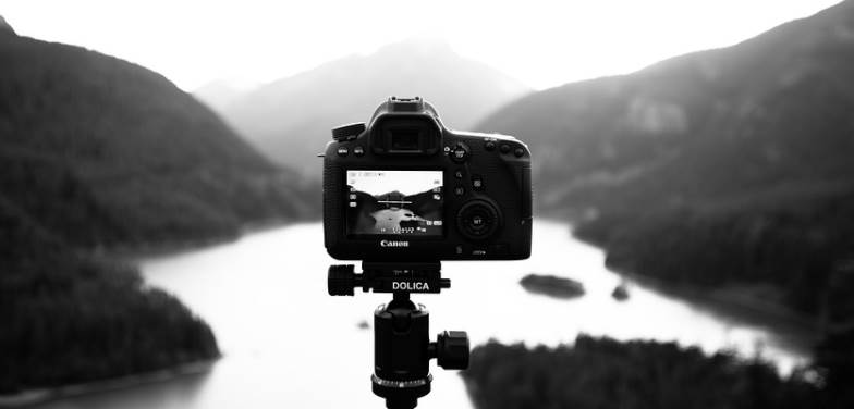 black and white photo of a DSLR