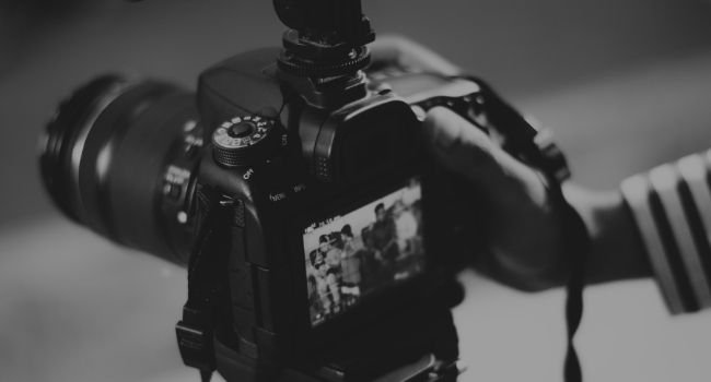 image of a camera capturing photo