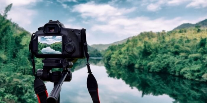 image of a camera standing beside lake