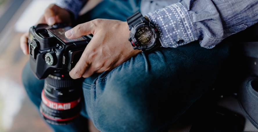 image of a man holding a camera