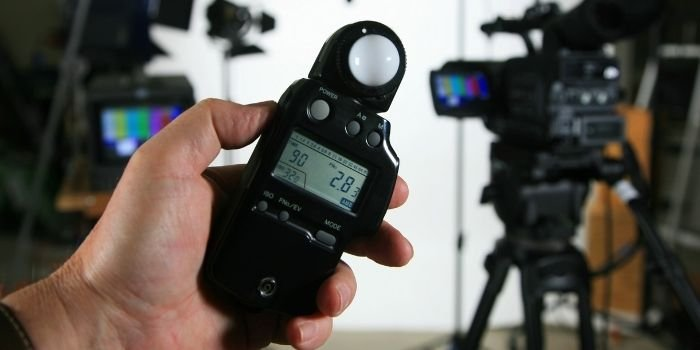 image of a person holding light meter
