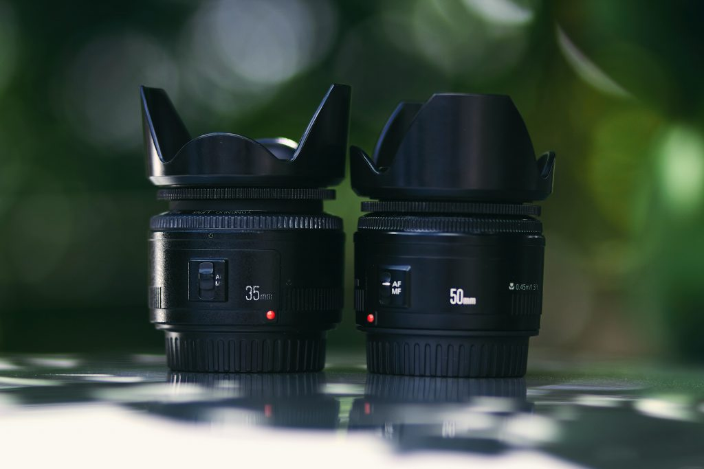 image of camera lens with hood on it